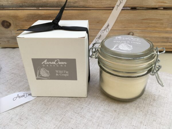Essential Oil infused wax candle in a glass storage jar